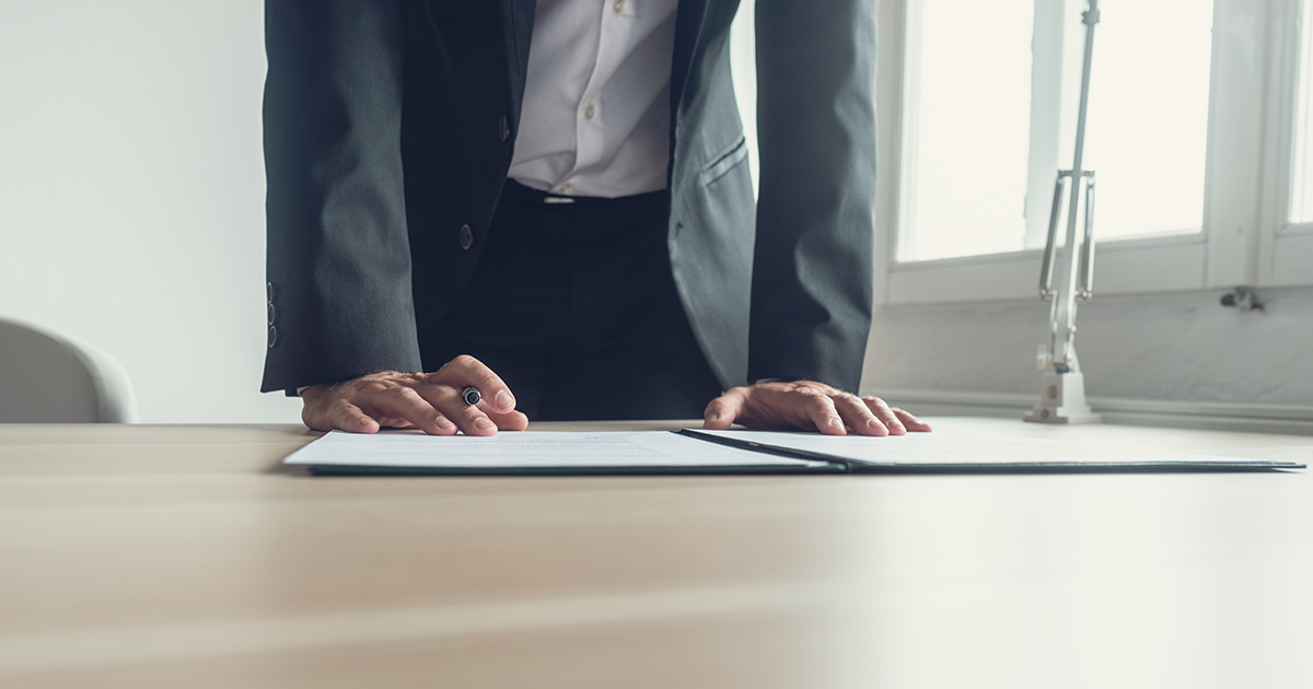 Business man leaning over documents