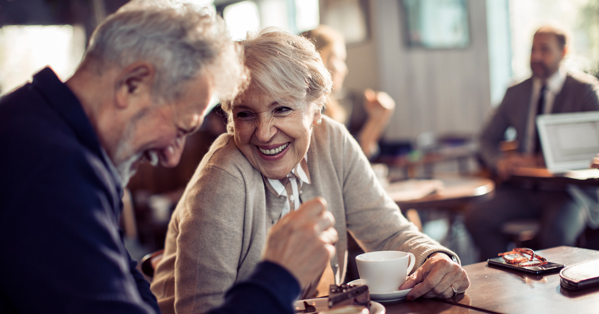 Retired couple drinking coffee