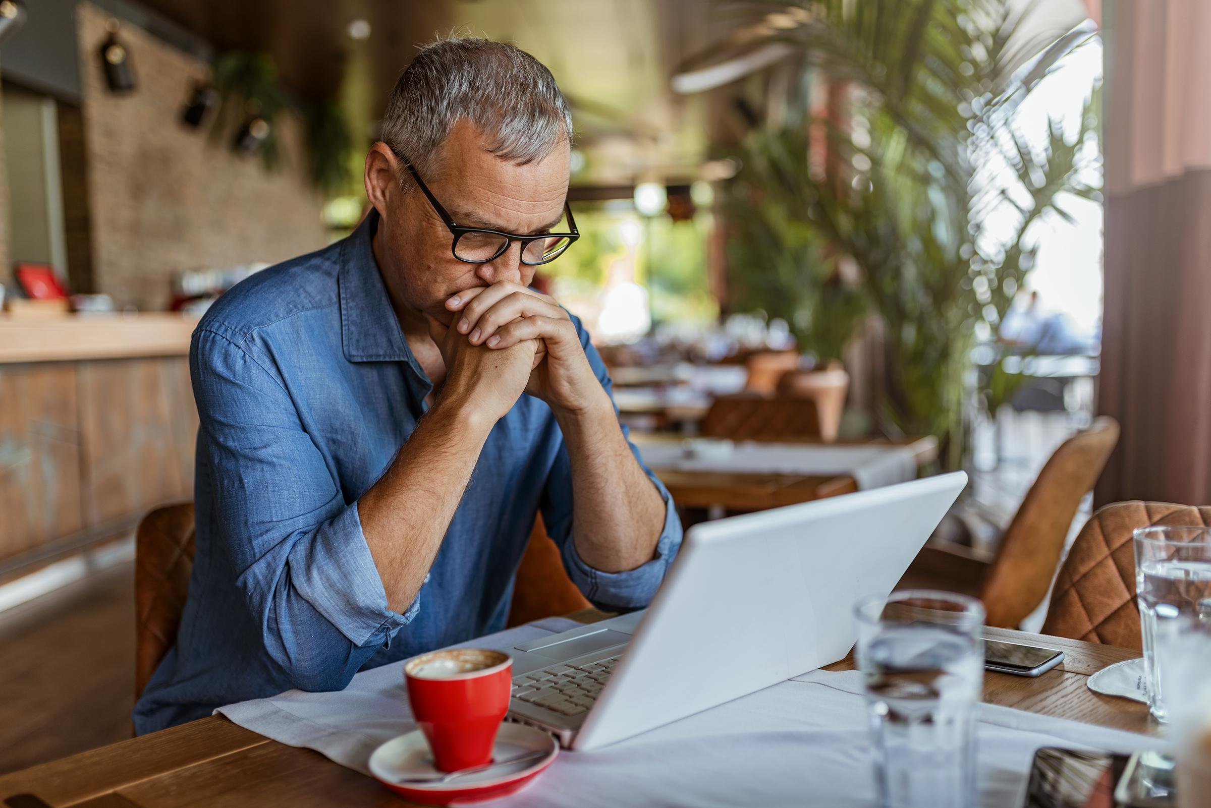 Man reading laptop