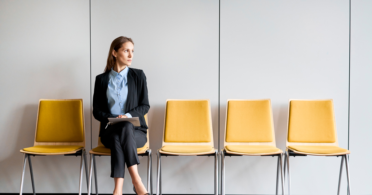 Business woman waiting on yellow chair
