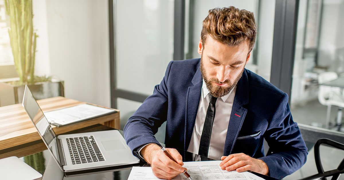 Man in suit working