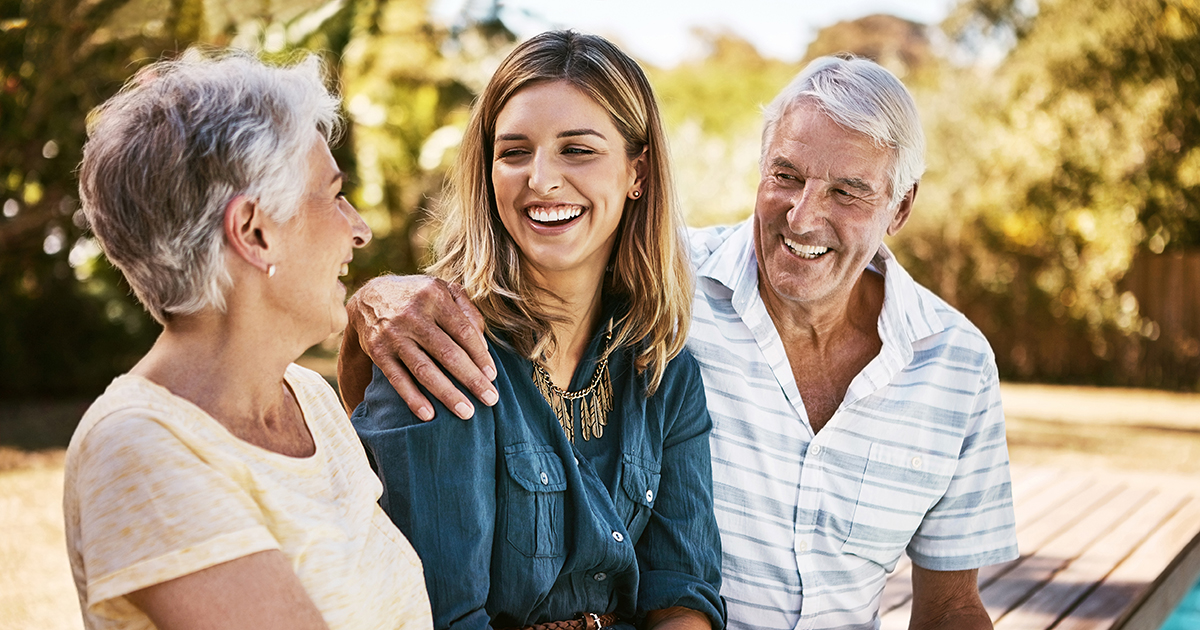 Retired couple enjoying time with adult daughter