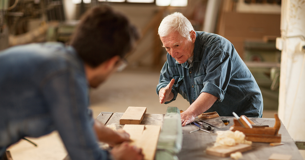 Elderly carpenter at work