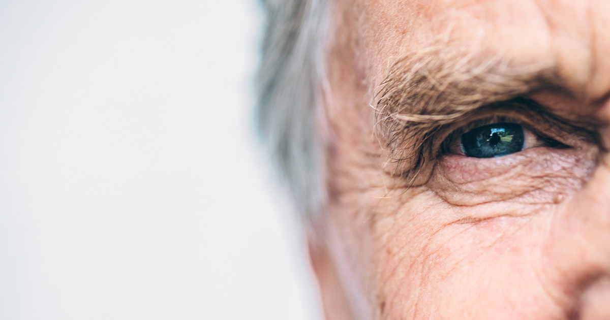 Blue eye of an older man