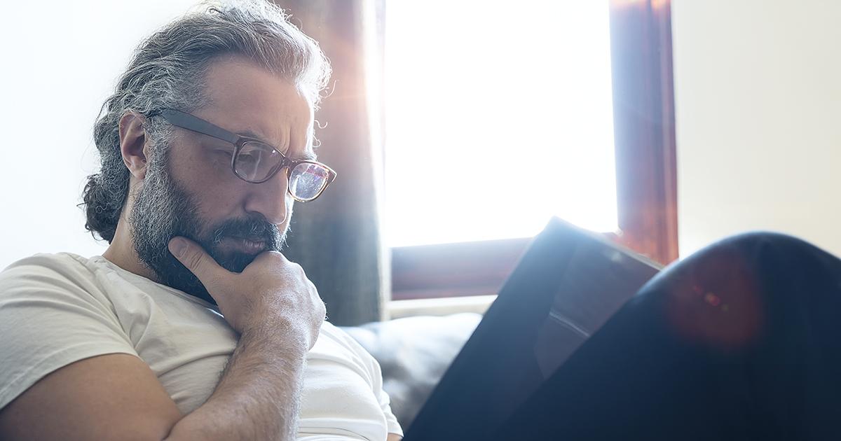 man considering paperwork