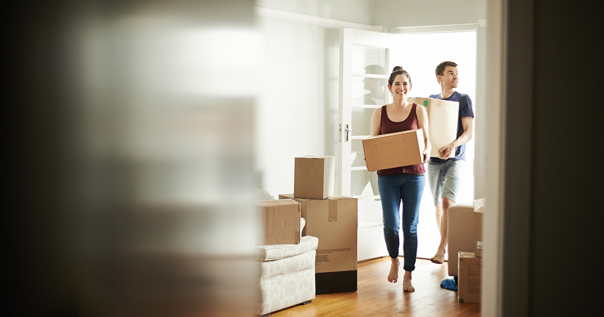 Young couple moving into house