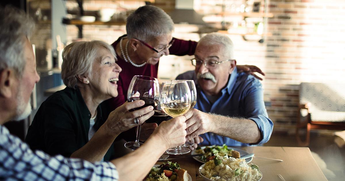 Two senior couples enjoying lunch