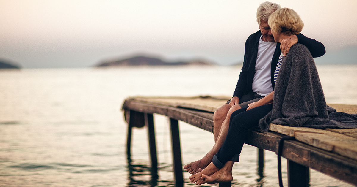 Retired couple sitting on jetty