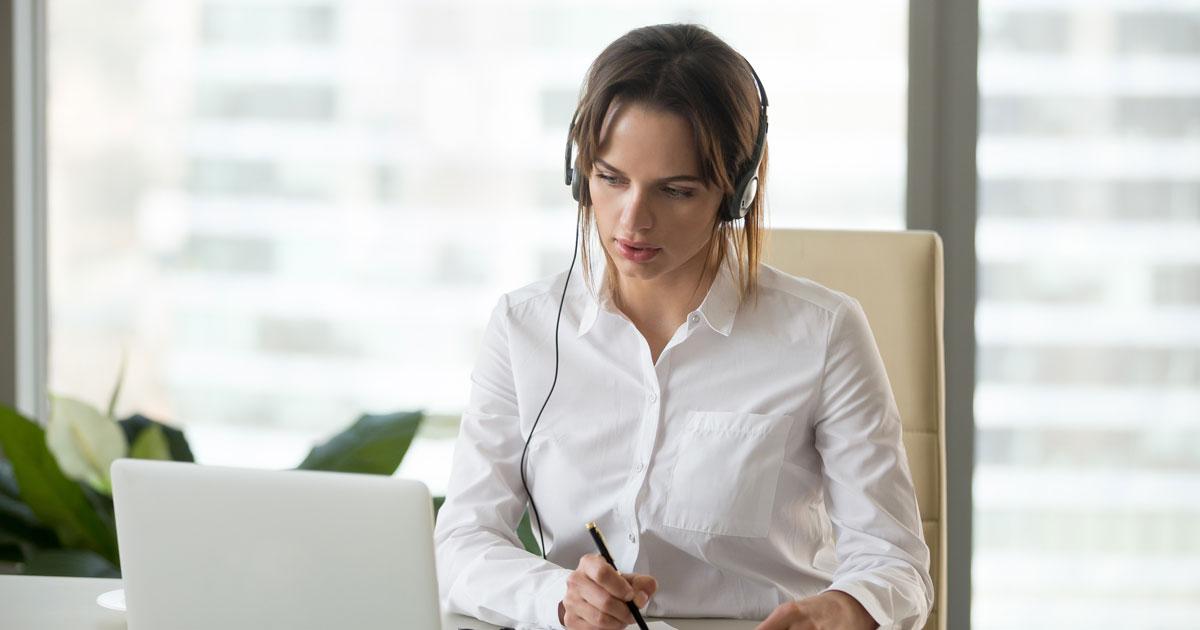 Woman listening to Heffron webinar